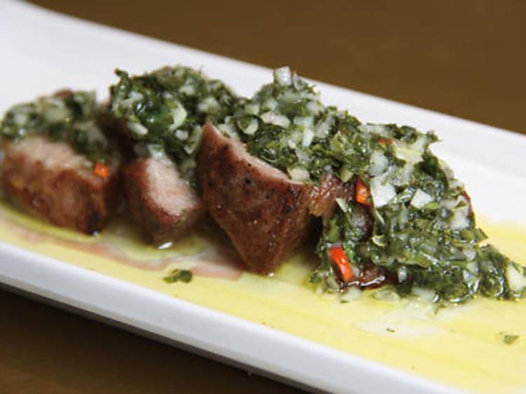 Pork presa with a chimichurri sauce (Timon Seafood Tapas)