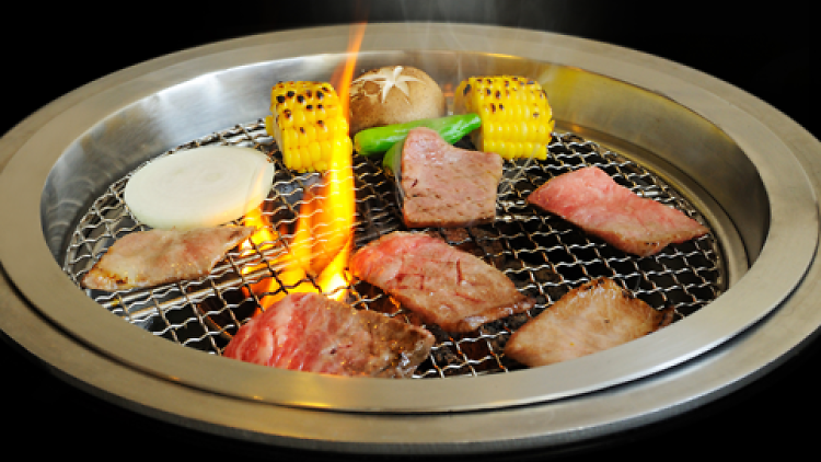 Meat and vegetables on a Korean barbecue
