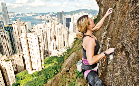 Woman rock climbing at Central Crags