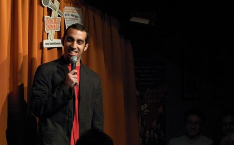 Comedian performing at Takeout Comedy