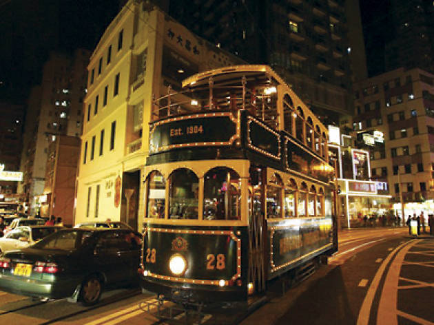 A tram lit up at night