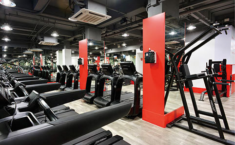 Interior shot of Utime gym, featuring rows of treadmills
