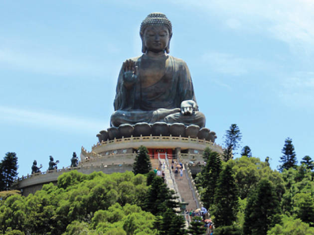 Tian Tan Buddha on Ngong Ping against blue sky far shot