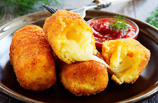 croquettes on a plate with sauce