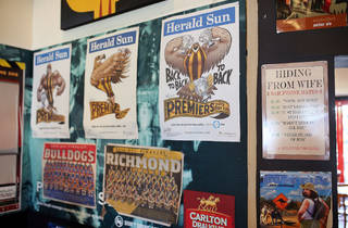 Footy posters at The Palace Hotel in South Melbourne