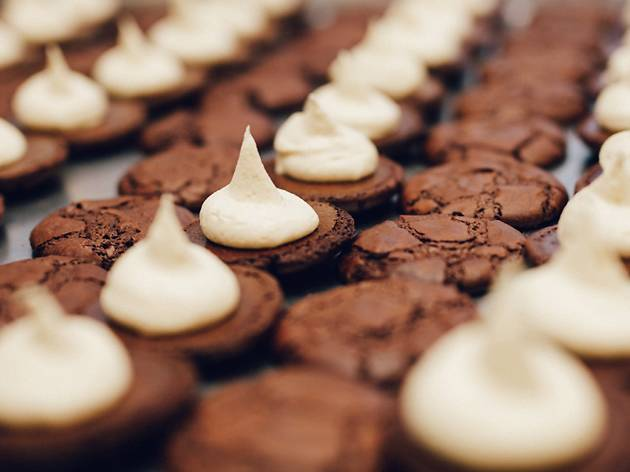 Photograph of chocolate brownie cookies (aka 'butterbings') topped with dollops of buttercream