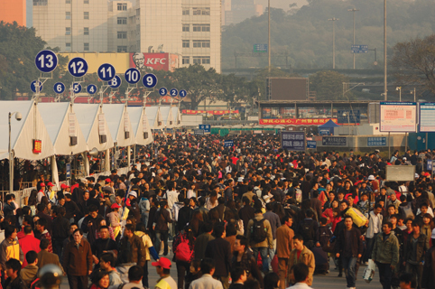 Pearl River Delta Megacity - Throngs of people at the Guangzhou train station