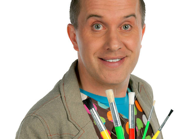 Mister Maker holding paint brushes