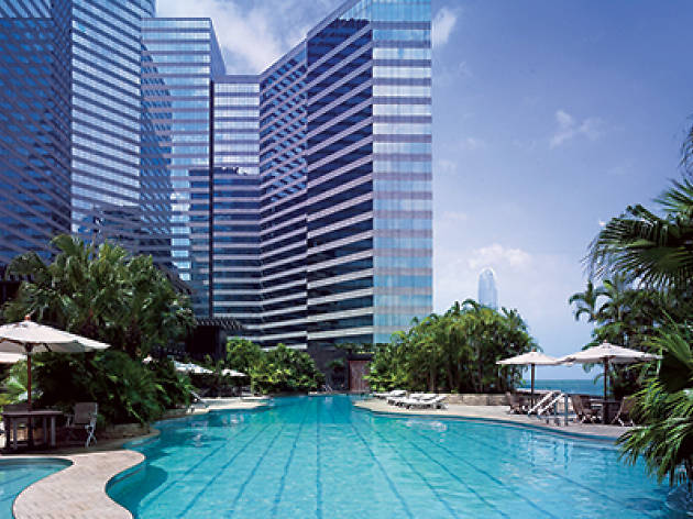 Shot of Grand Hyatt Main Pool with skyscrapers in background