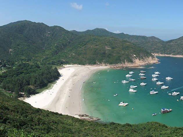 Shot of Long Ke Wan Beach with boats in distance
