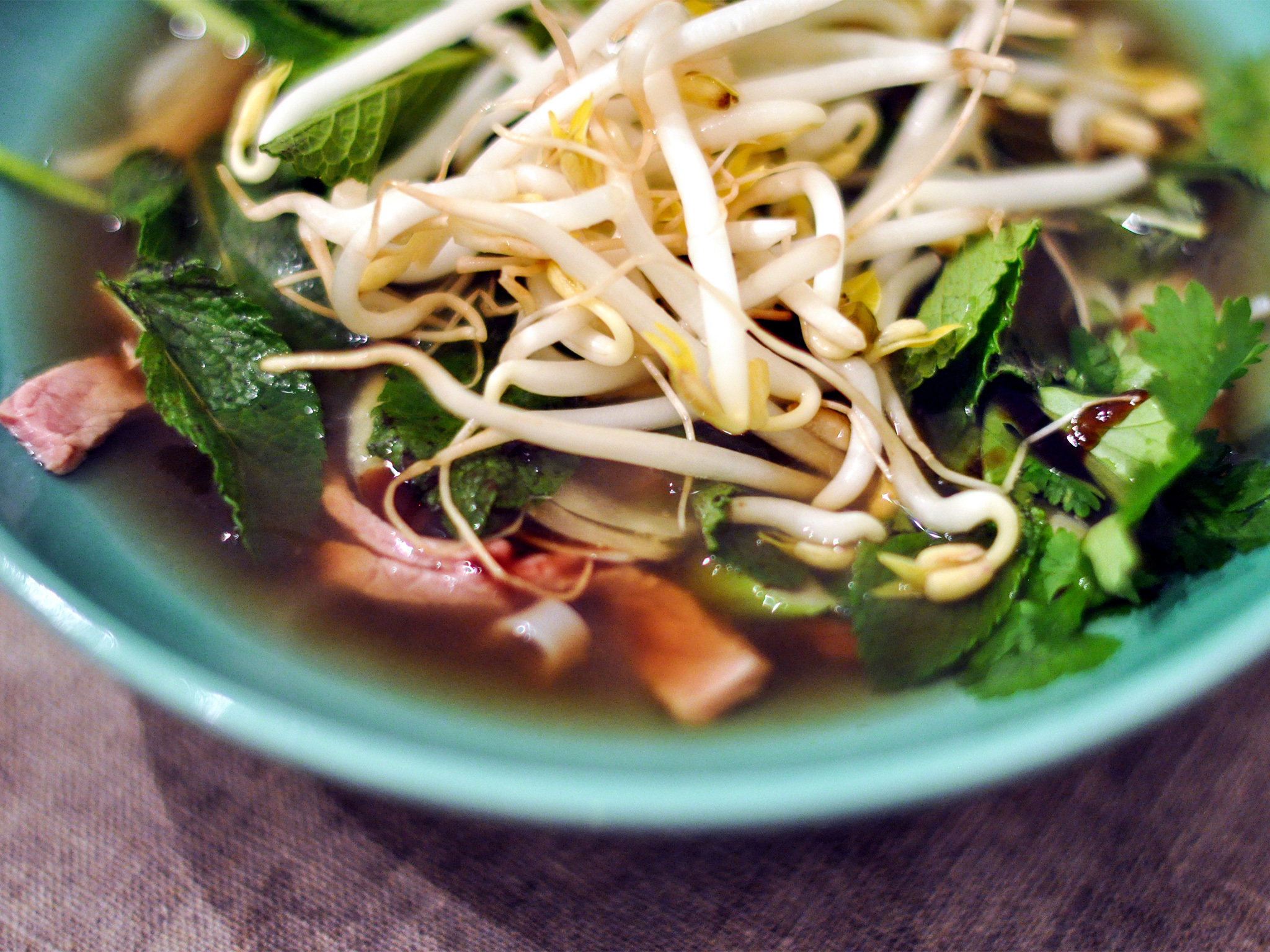 Bowl of pho soup with bean sprouts