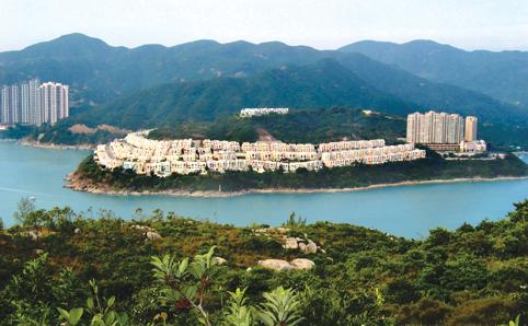 Shot of houses sprawled along Tai Tam coastline