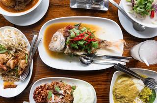 An array of thai food on a table