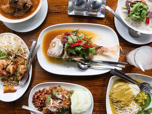 An array of thai food on a table