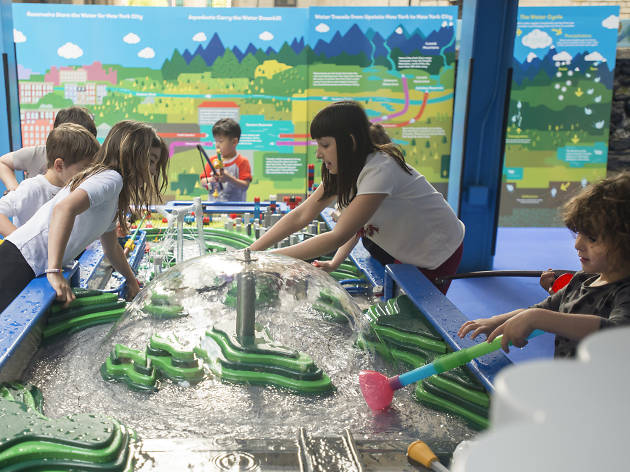 Children enjoy playing with the new 16' interactive model of  NYC's municipal water system at the Children's Museum of Manhattan's newest exhibit, Dynamic H20