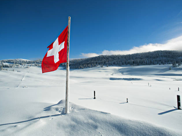 SWITZERLAND PARKS, swiss flag in the snow
