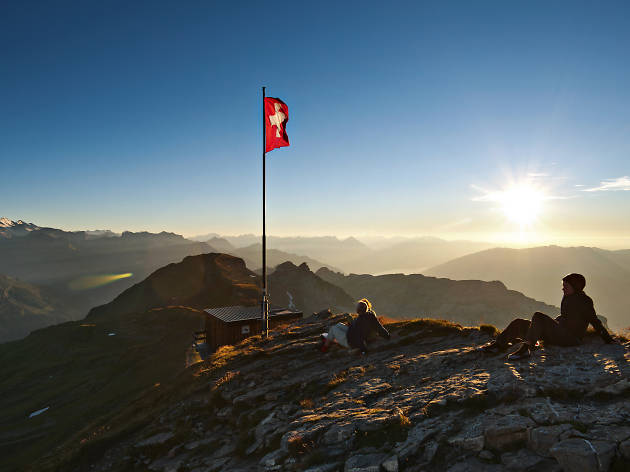 Swiss flag, mountain sunset, Bernese oberland