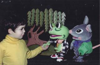 Kid participating in a puppet show