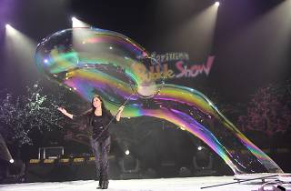 Performer creating bubbles on stage