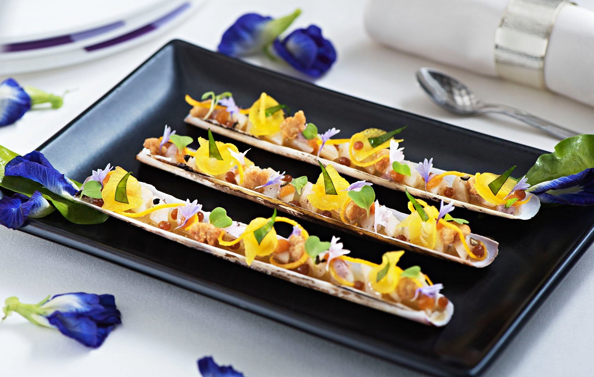 Razor clams in their gelee with crispy sweetbread, green peppercorn, citrus puree and Grand Marnier pearls