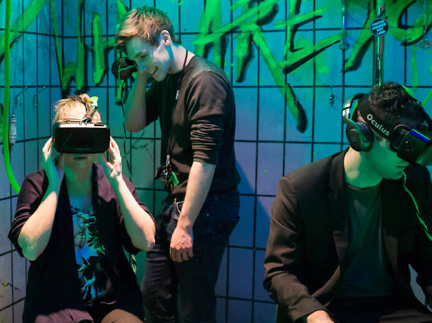 Three people wearing virtual reality headsets