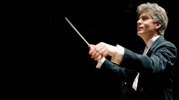 Shot of Jerome Hoberman conducting an orchestra