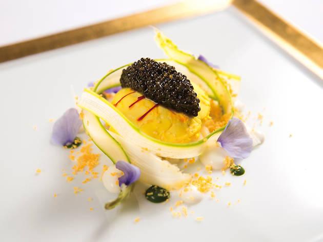 Poached saffron-flavoured organic egg with white asparagus and Oscietra caviar