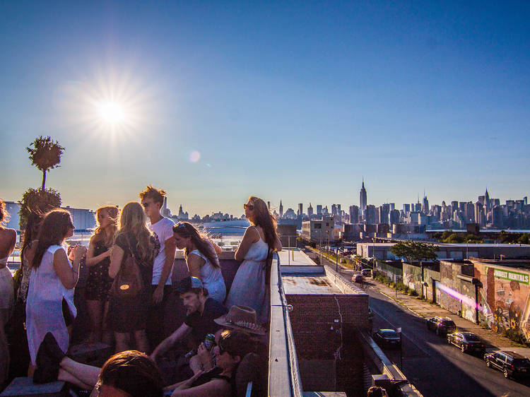 Go to a rooftop party at Output