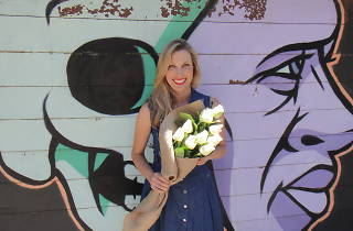 Courtney Ray holding a bunch of flowers