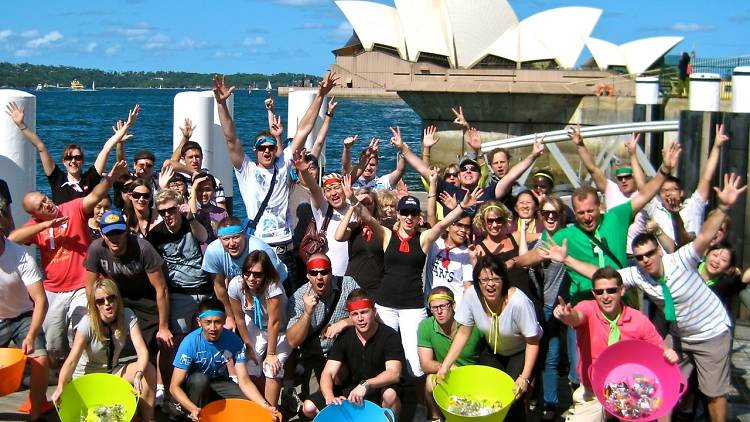 People cheering at an Amazing Race event at Sydney Harbour