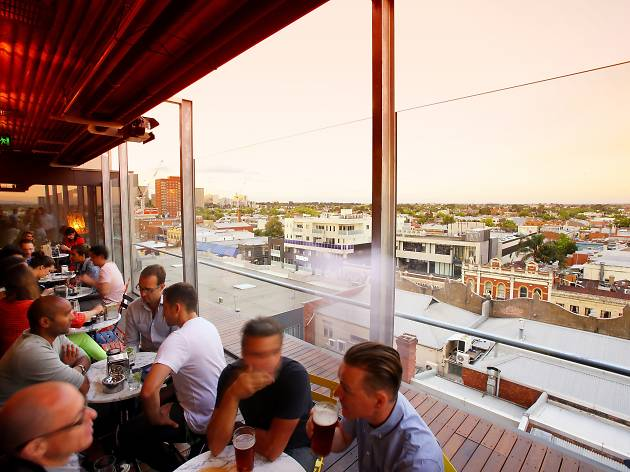 People enjoying drinks at Fitzroy rooftop bar Naked in the Sky