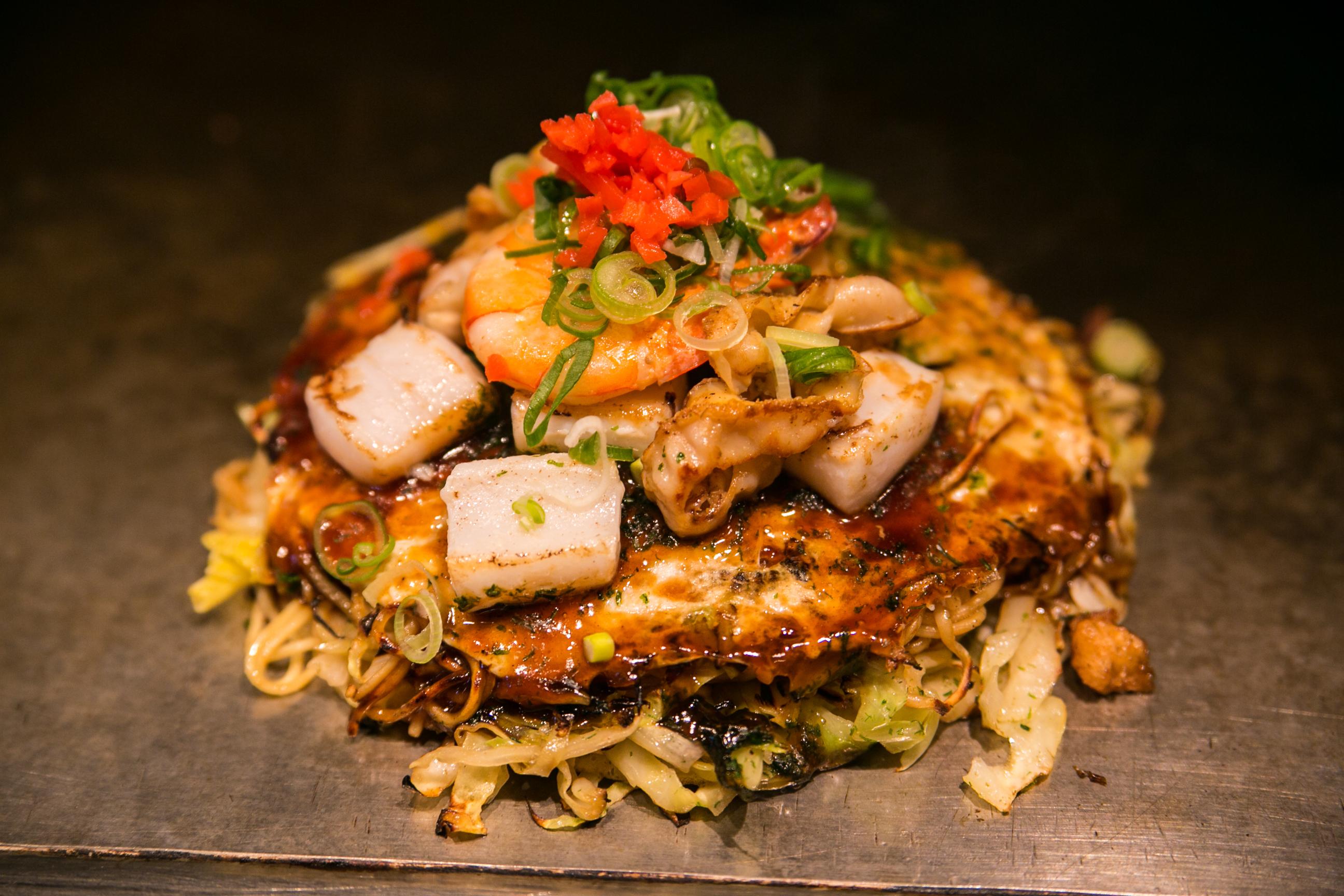 Try Hiroshima-style okonomiyaki...