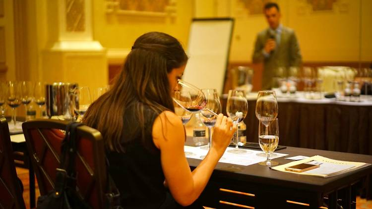 Woman sampling wine in class