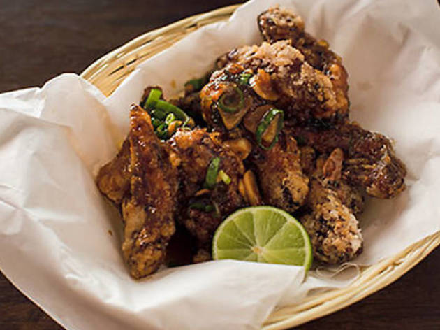 Basket of fried chicken with a cheek of lime on the side