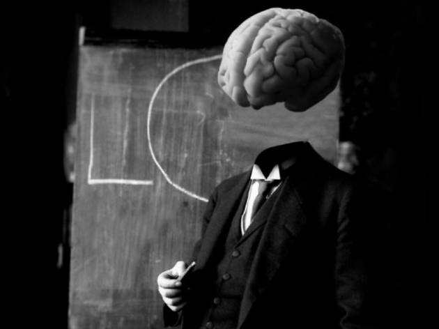 Brain, suit and blackboard