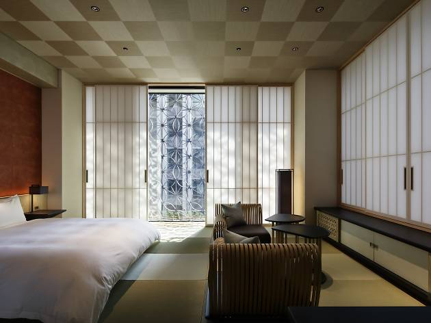 Sliding washi screens and tatami mats with soft futon beds make up the standard room at the Hoshinoya Hotel.