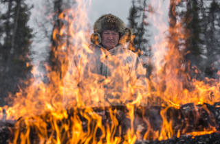 (James Morgan: Yakutia, Russia, burning the latest wolf corpse.  Winner, Nature & Environment 2015)
