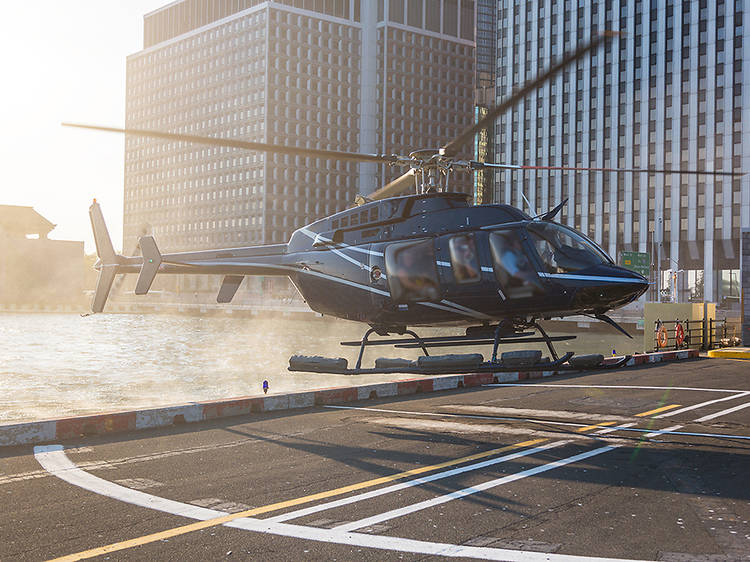 Soar over the city on a helicopter tour