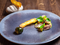 Pheasant and white asparagus on ceramic plate