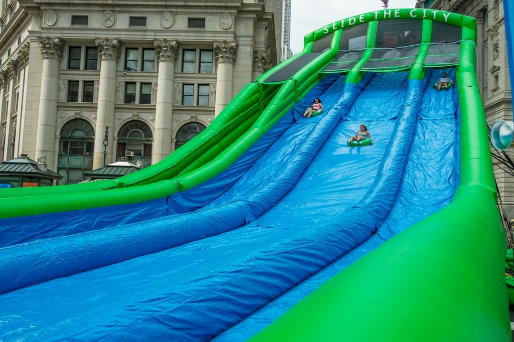 Register for the massive water slide at Summer Streets right now!