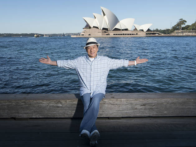 Jackie Chan sitting in front of Sydney Opera House