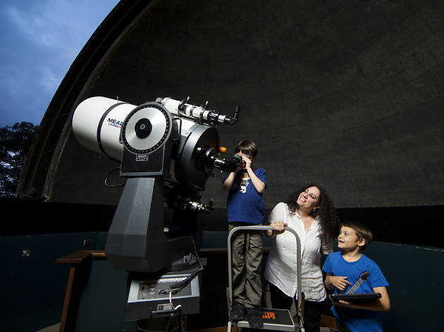 Family looking through telescope