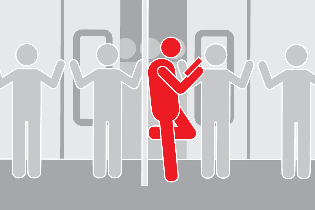 Keep your spot leaning on the pole when people are trying to exit and enter a packed train