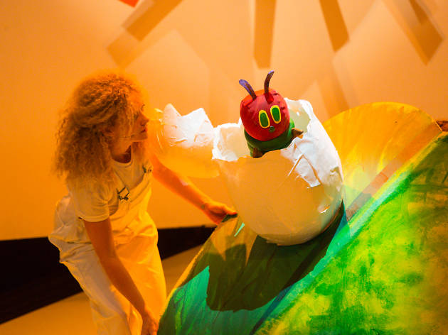 Performer and puppet on stage in The Very Hungry Caterpillar