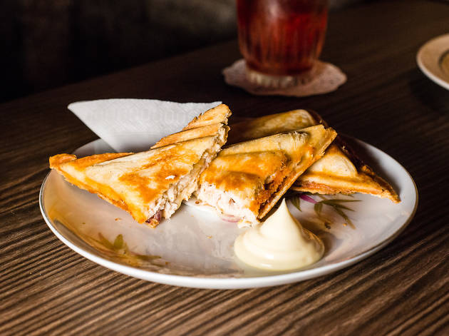 A toasted sandwich on a plate with mayonaise