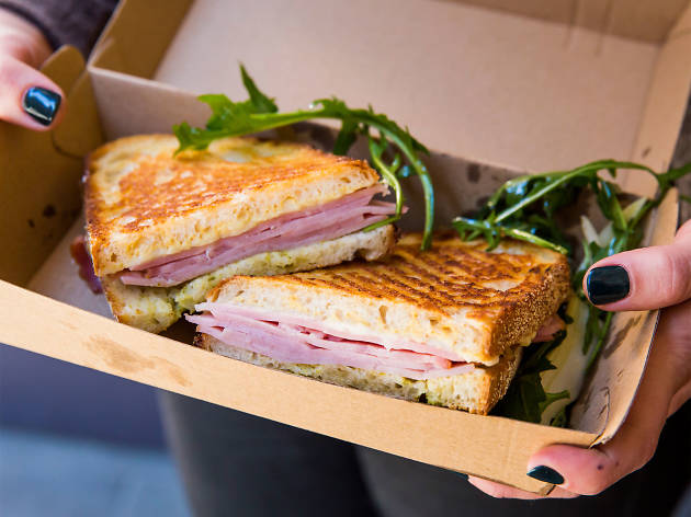 a toasted croque monsieur in a cardboard box