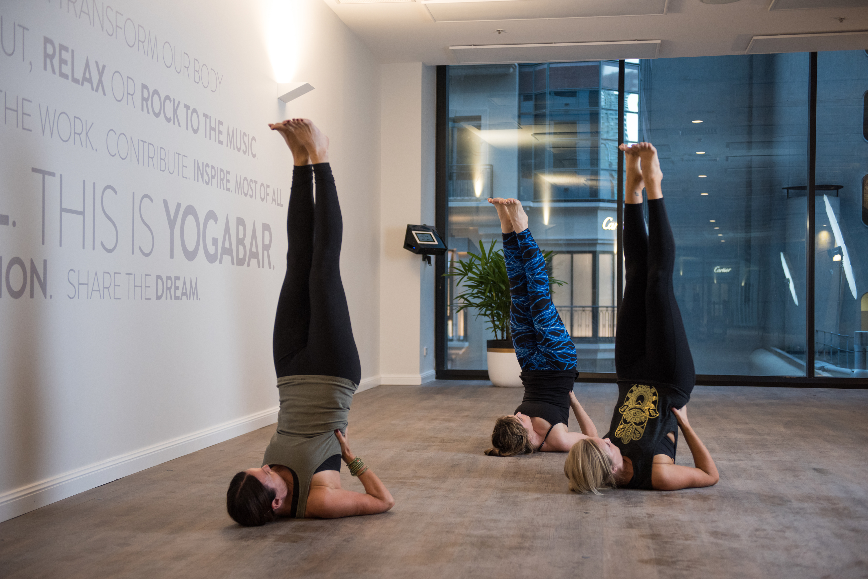 Three women in yoga positions