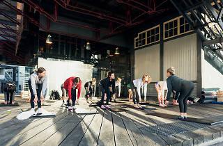Women practising yoga at Walsh Bay