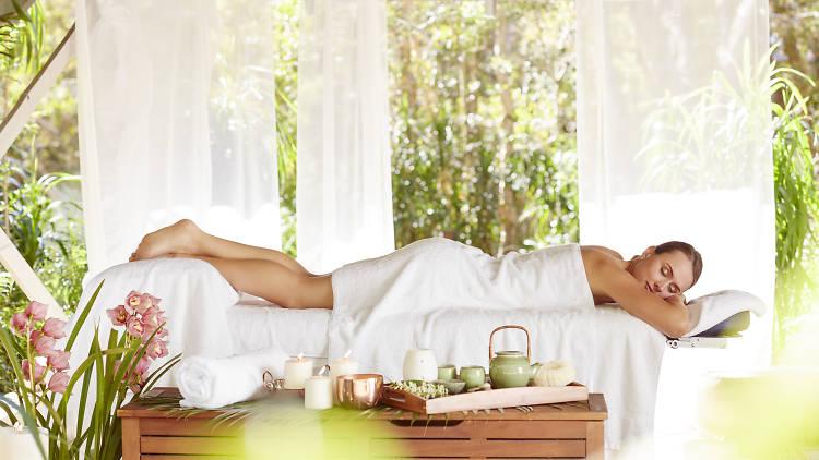 Woman on a massage table at Byron at Byron Resort and Spa