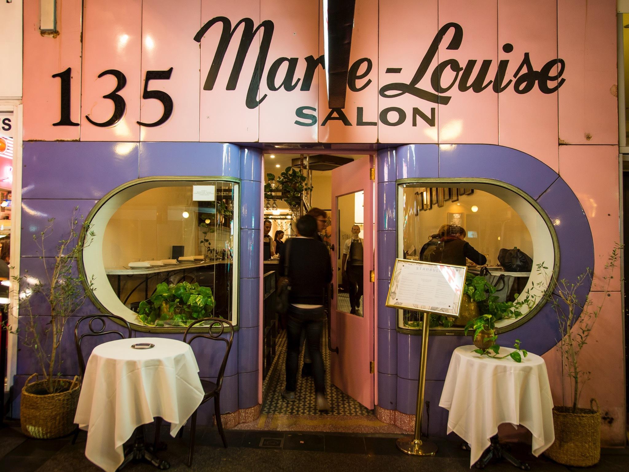 Exterior of the restaurant with a vintage hair salon facade
